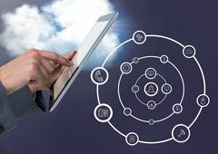 Man using digital tablet with digitally generated application icons Stock Photos