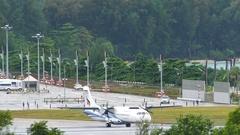 Turboprop Bangkok Airways airplane on taxiway Stock Footage