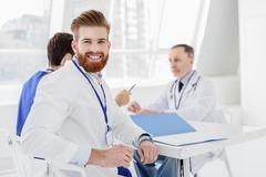 Joyful medical team discussing human health Stock Photos