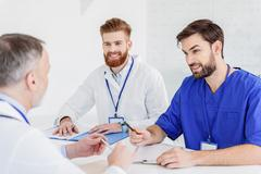Experienced general practitioner explaining ideas to colleagues Stock Photos