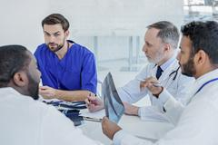 Smart doctors gathering council at clinic Stock Photos
