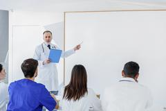 Experienced general practitioner explaining information to students Stock Photos