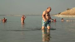 People swim in Dead Sea, Jordan Stock Footage