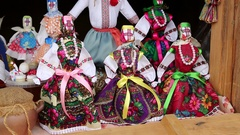 Colorful dolls of Ukrainian women in traditional clothes in souvenir shop Stock Footage