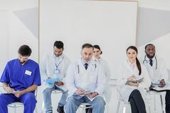 Serious general practitioners diagnosing disease Stock Photos