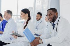 Professional general practitioners having conversation at clinic Stock Photos