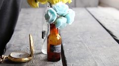 Happy Valentines Day label and nice flowers in the decorative bottles Stock Footage