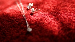 Earring and a chain with a pendant shimmer in the sunlight Stock Footage