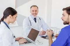Skillful general practitioners discussing human health Stock Photos