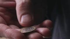 One euro coin in male hand Stock Footage
