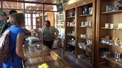 Tourists in the Cuban cigar store (Casa del Tabaco). Trinidad, Cuba Stock Footage