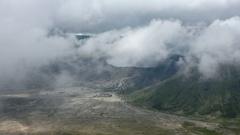 Landscape with Pura Luhur Poten hindu temple near Bromo volcano. Java, Indonesia Stock Footage