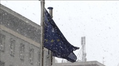Two European Union Flags in Snowy Weather. Stock Footage