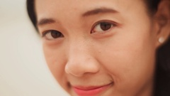 Charming Vietnamese Girl laughing. Face close-up Stock Footage