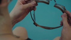 Goggles for swimming in the women's hands. Accessories for professional swimmers Stock Footage
