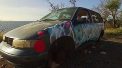 Abandoned van, car, destroyed, wrecked,  Graffiti Art. Aerial Fly Around Stock Footage