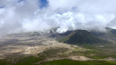 Volcanic eruption against blue sky. Mount Bromo, East Java, Indonesia Stock Footage