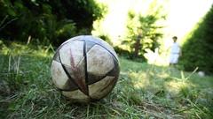 Young boy kicking ball. Child kicks balls. Kid kicking soccer ball Stock Footage