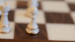 A dolly closeup shot of chess pieces on board before game Stock Footage