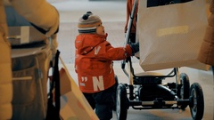 2 year little baby boy start ro roll his baby carriage. Shopping with small Stock Footage