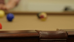 A dolly shot of lady playing pool in a retirement home Stock Footage
