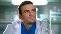 Portrait of scientist thinking in lab. Close up of serious scientist Stock Footage