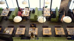 Peoples in morning cafe. Shot from top. Areal shot Stock Footage
