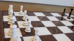 Dolly shot of chess pieces on board before game Stock Footage