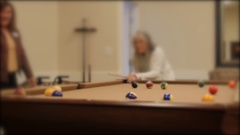 Shot of a lady playing pool in a retirement home Stock Footage