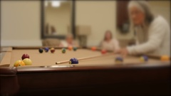 Shot of women playing pool in a retirement home Stock Footage