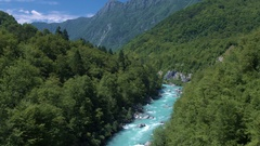 Aerial - Panoramic view of Soča river running through the mountain valley Stock Footage