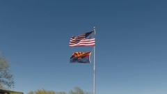 USA Flag And Arizona Flag Flying In Strong Breeze Stock Footage