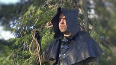 Executioner with noose rope in hand Stock Footage