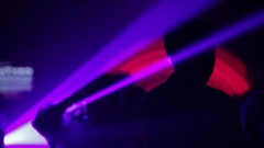 People dancing together in a night club. Silhouette Stock Footage