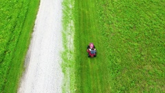 Young boy with red lawn mower Stock Footage
