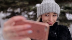 Young girl in fashionable winter clothes posing for a selfy photography. Stock Footage