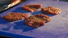 Close up of pouring meat chops with souce. Slow motion Stock Footage