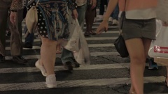 CLOSE UP: Detail of human legs walking on pedestrian crossing during the night Stock Footage