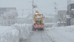 Snow Clearing Machinery Clears Road During Blizzard Stock Footage