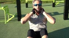 Man doing pushups outside on training ground Stock Footage
