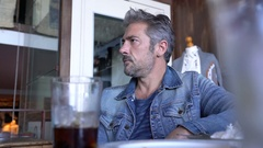 Man sitting in bar drinking soft drink Stock Footage
