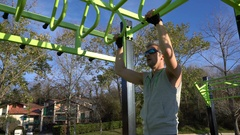 Athletic man exercising in outdoors sports ground Stock Footage