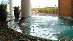 Woman lying in the hotel pool. UltraHd 4k video Stock Footage