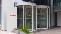 Street signage board with Toshiba Corporation logo. Modern office building Stock Footage