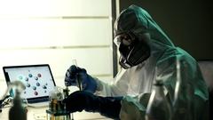 New variety GMO plant in vitro in modern bio laboratory. Elderly skilled Stock Footage