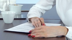Woman hand with red nails signing contract Stock Footage