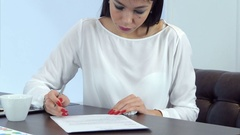 Young busy woman feeling not well but continuing signing papers Stock Footage