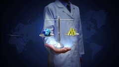 Researcher, Engineer, doctor open palm, Balanced earth and gold coin, money Stock Footage