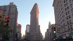 CLOSE UP: Driving in touristic bus toward past Flatiron Building at sunset in NY Stock Footage