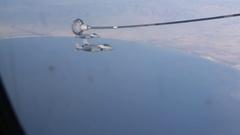 US Air Force – Lightning II fly beside tanker Stock Footage